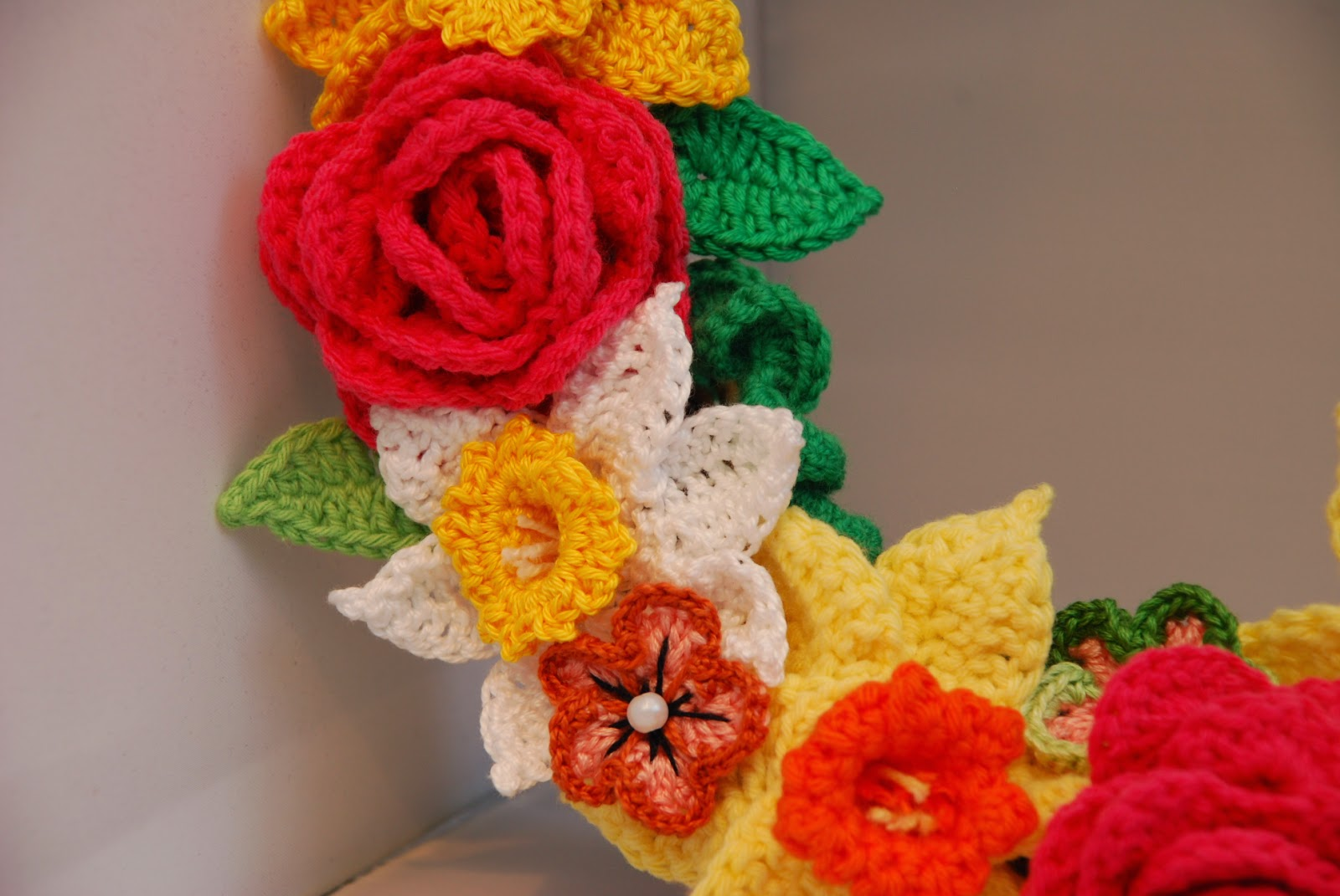 image of crochet Spring wreath; crochet daffodils and roses