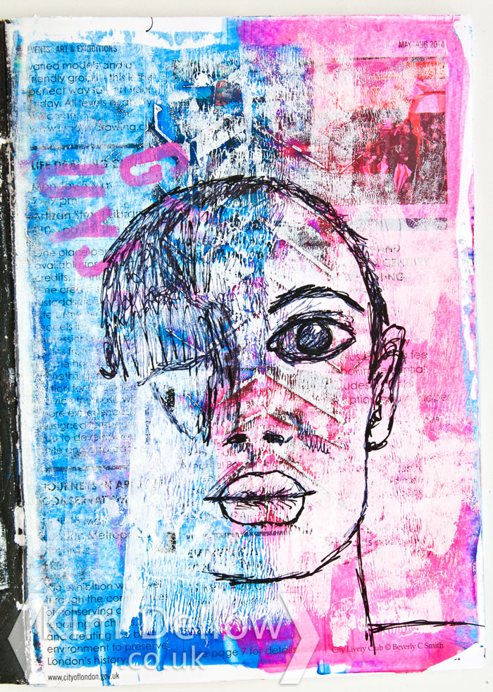Scribbling a face on an art journal
