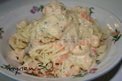 Shrimp in a creamy Velveeta pasta sauce over angel hair pasta.