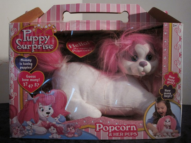 "2014 Puppy Surprise ""Popcorn"", new in packaging."