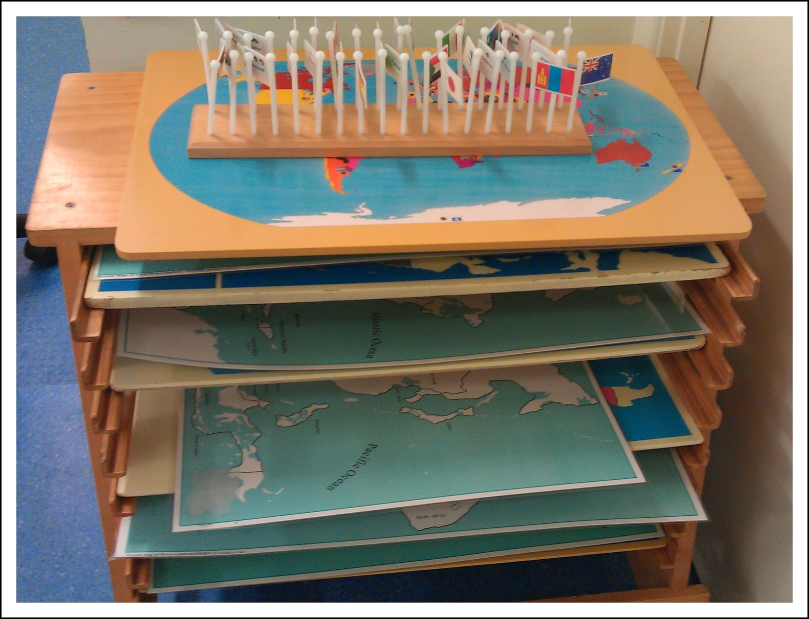 Teaching geography in the montessori classroom montessori nature montessori world map with flags this activity can be too challenging for children on its own we usually provide flag book to facilitate them to search for gumiabroncs Images