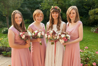 Real vintage bride Olivia in 1960s lace vintage wedding dress, bridesmaids in garden
