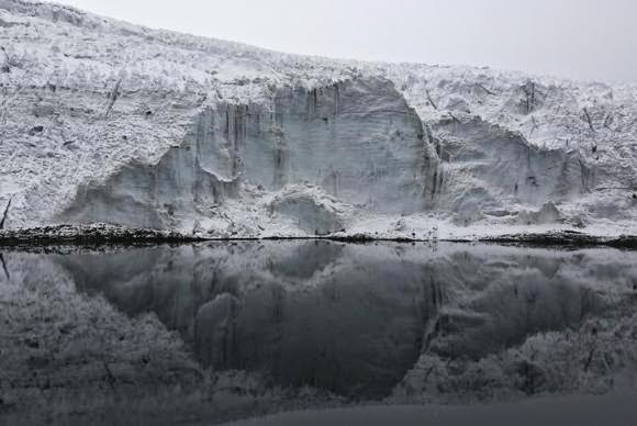 A view of the lake formed by meltwater from the Pastoruri glacier, as seen from atop the glacier in Huaraz, Peru, September 19, 2013. (Credit: Reuters/Mariana Bazo)   Click to Enlarge.