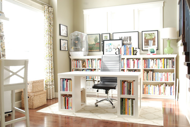 awesome black small office chair with the leather material and wheel legs along with mini library and minimalist white computer desk