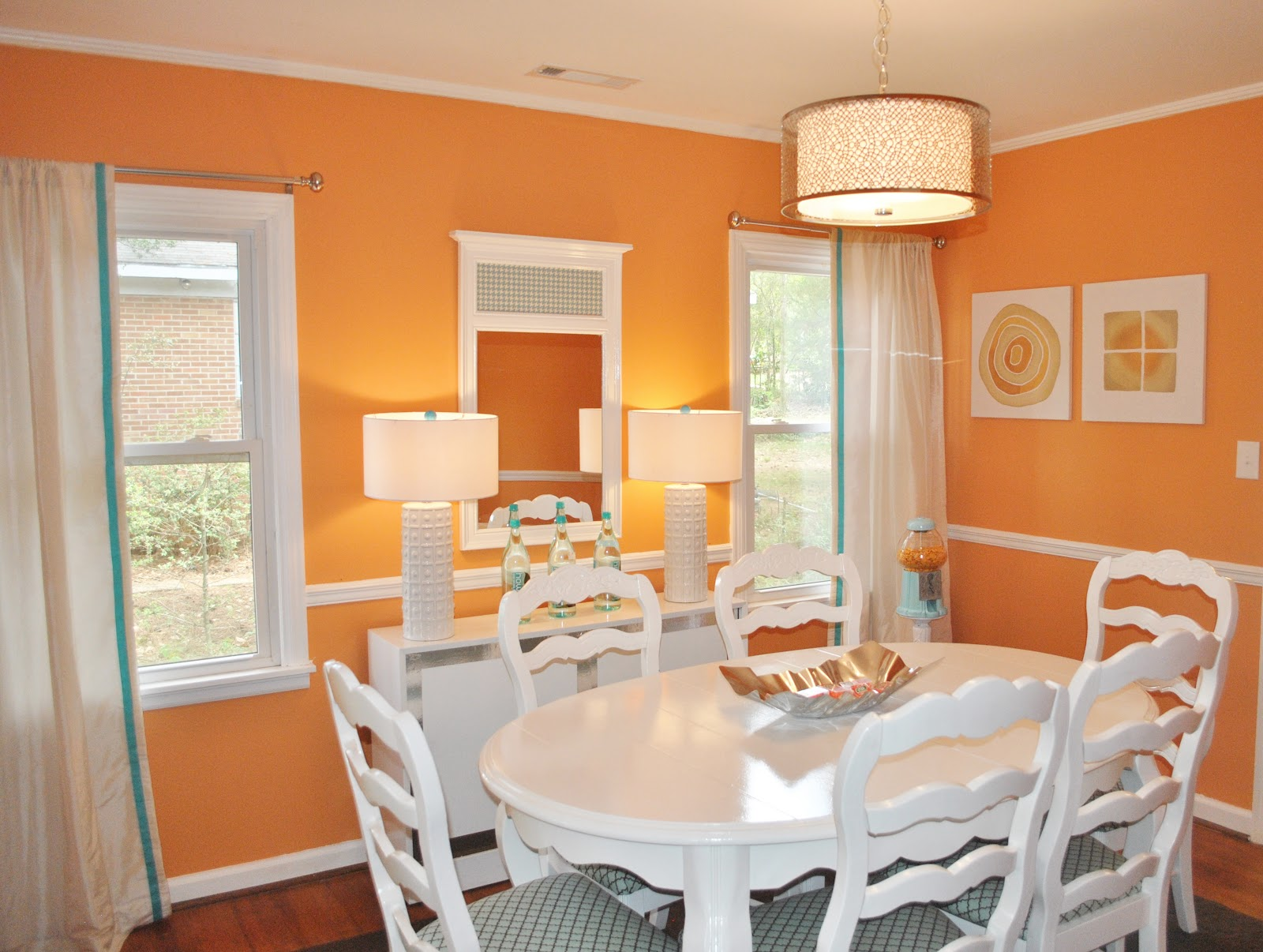 Bright Orange Dining Room Also Appears In The Pictures Below. Wooden Dining  Table And Chairs Combine With Chandelier And Red Rose On The Table Makes  This ...