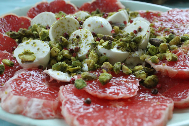 Star Ruby grapefruit, mozzarella, pink peppercorns and pistachios