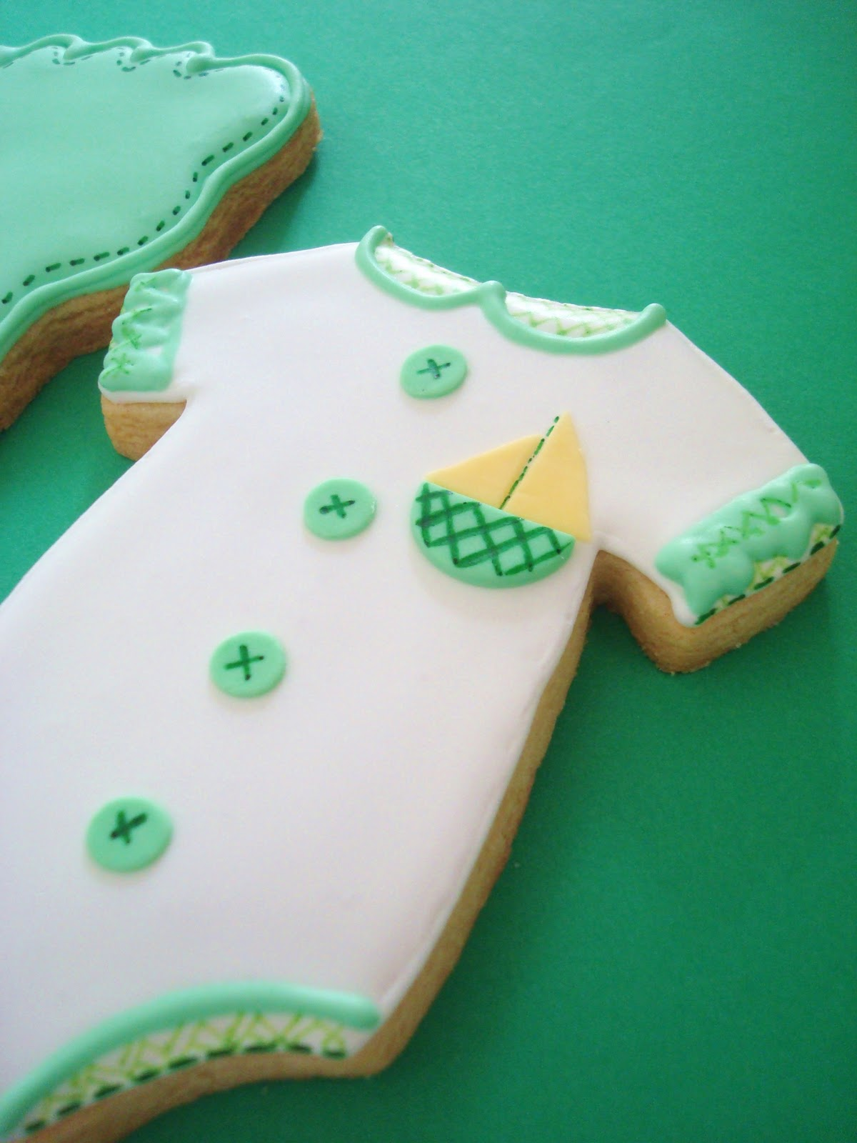 pink little cake green and white baby shower cookies