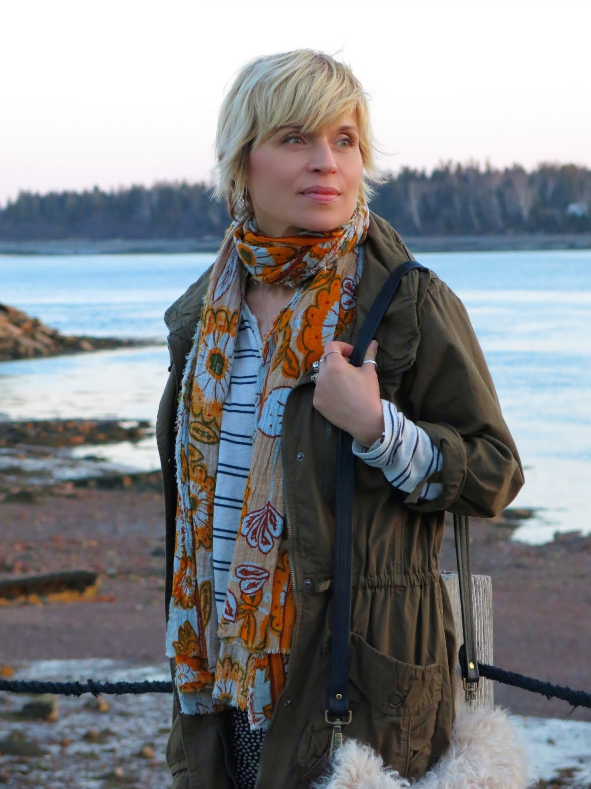 styling dotted skinnies with a striped top, floral scarf, army jacket and boots