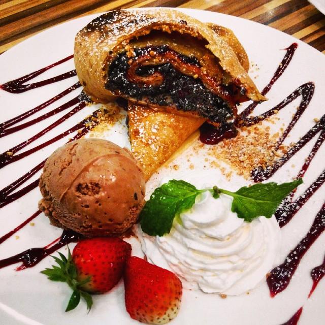 Chocolate Crepe dessert with ice cream and whip cream