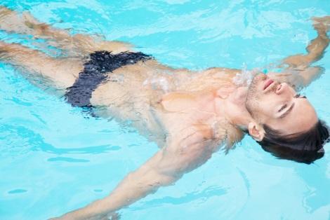 Nick Steele floating in swimming pool by Greg Lotus