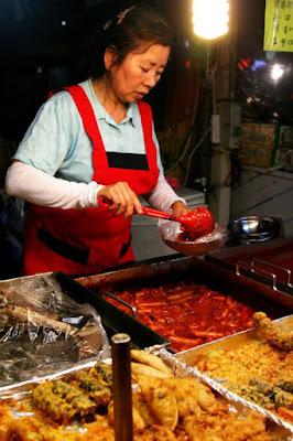 Ahjumma selling ddeokbokki in Dongdaemun Seoul