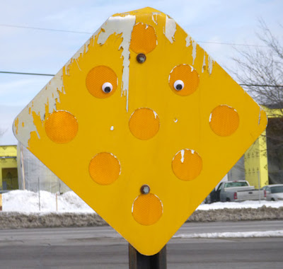 intersection sign with googly eyes