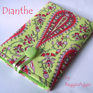 Scrumptious pistachio green and strawberry pink Kindle case, handmade in the UK.