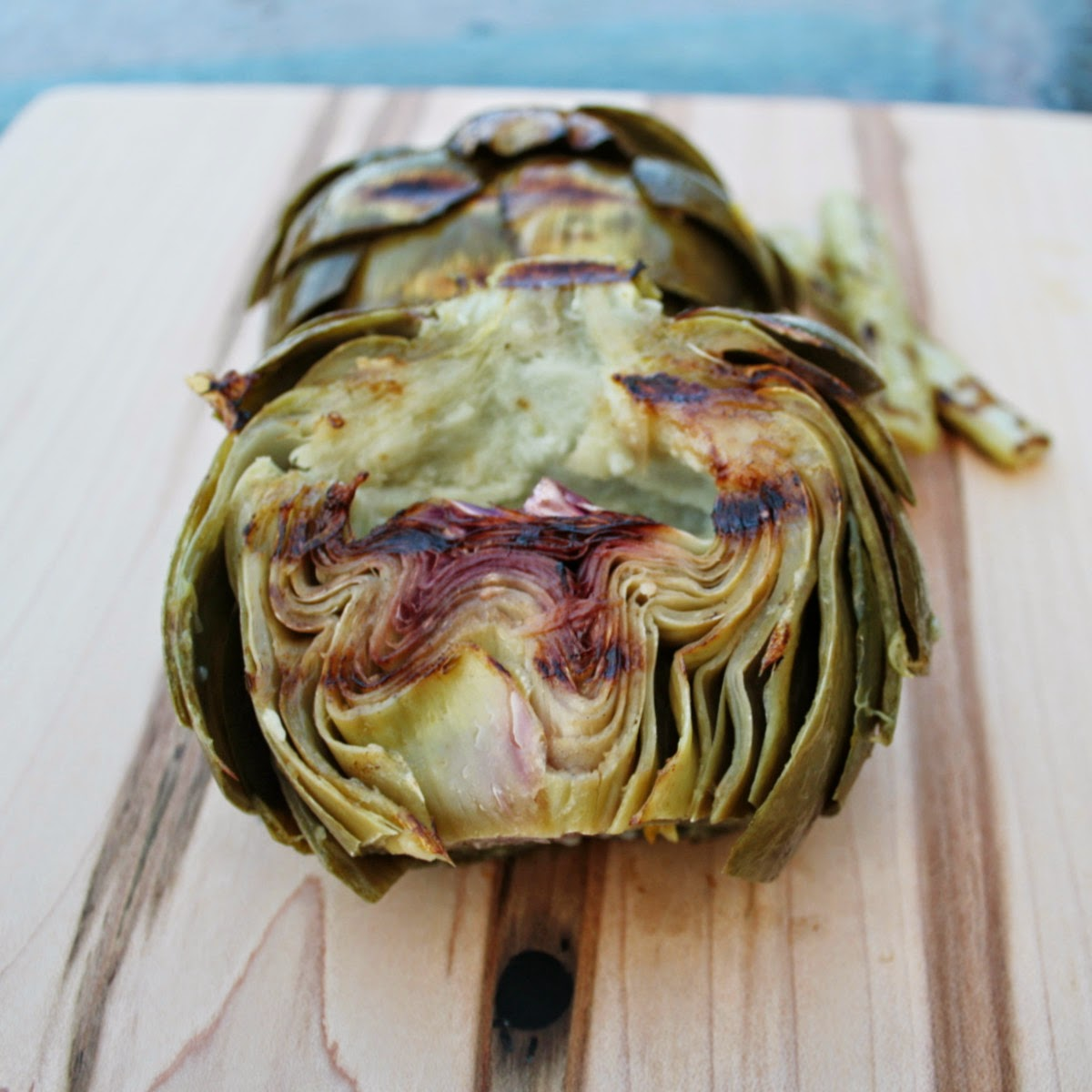 Grilled artichoke with a hint of lemon, ginger and garlic