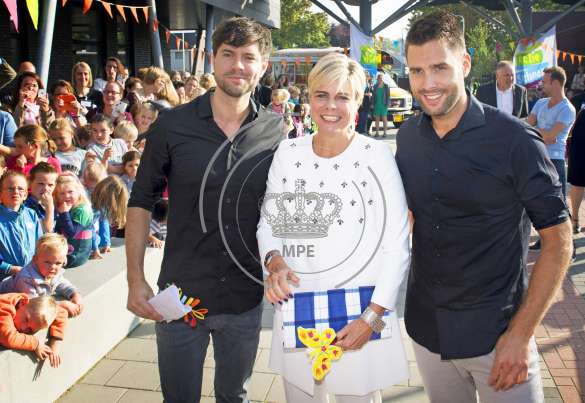 Princess Laurentien of The Netherlands starts with Dutch singers Nick and Simon the 20th edition of Edukans Schoenmaatje at the Brede school de Zandkampen in Zaltbommel, The Netherlands