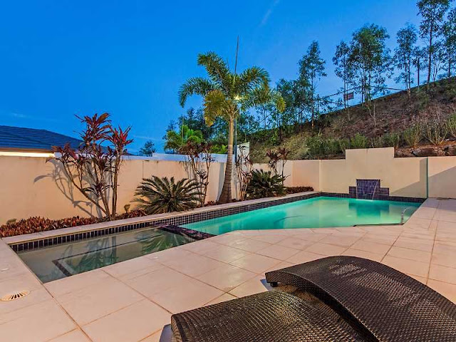 Picture of the backyard with swimming pool