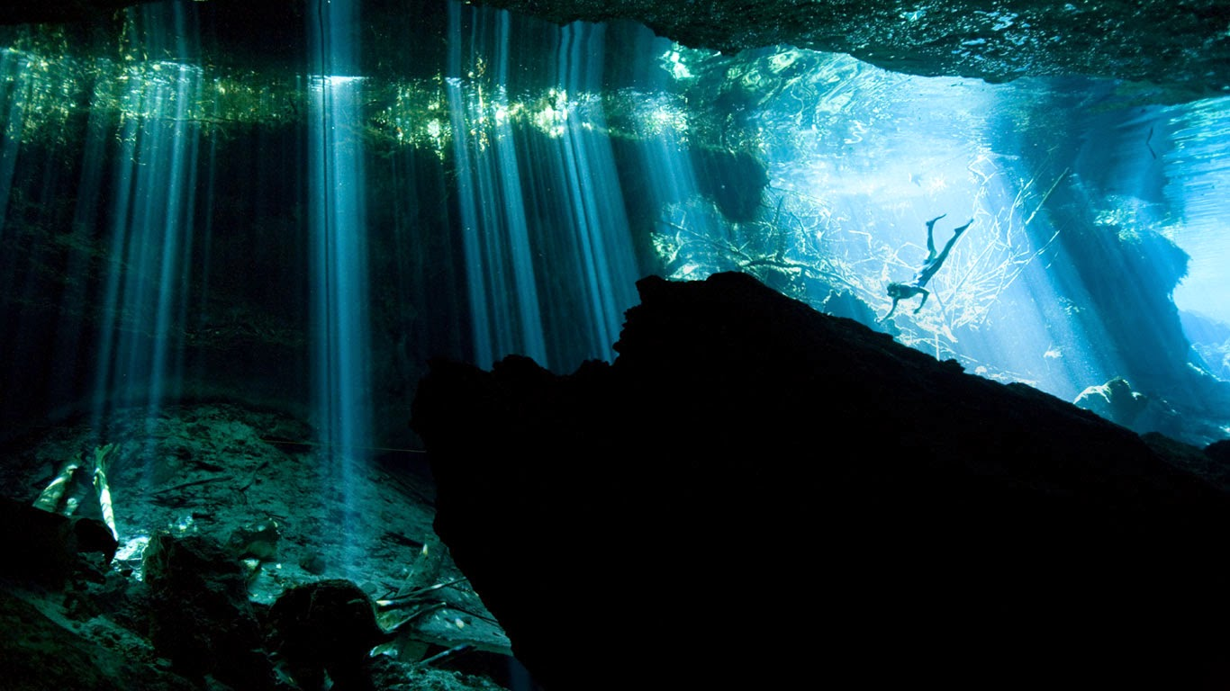 Diver in a cenote near Akumal, Mexico (© Paul Nicklen/Getty Images) 533