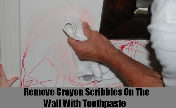 Cleaning crayon scribbles on the wall