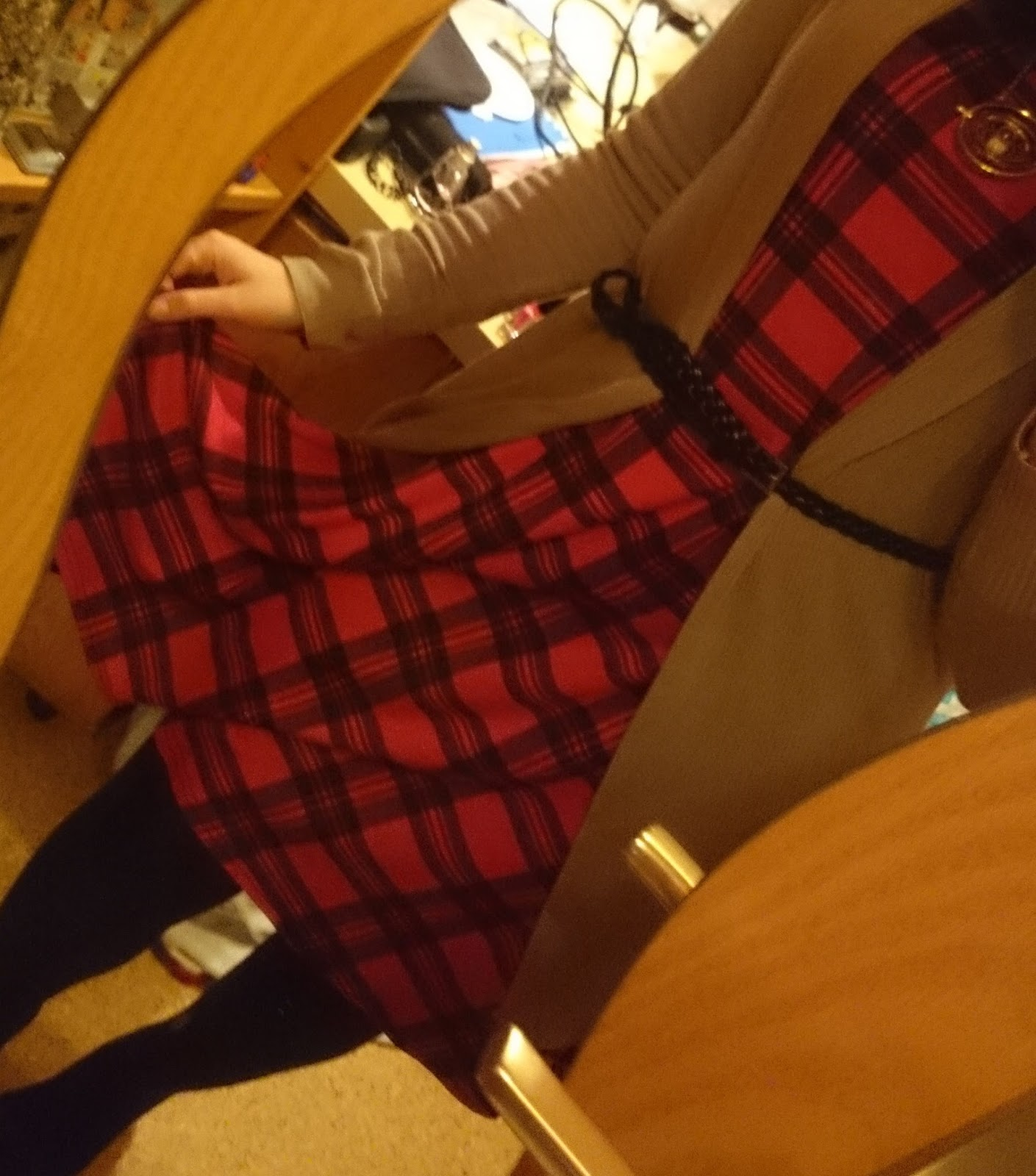 combine a tartan dress