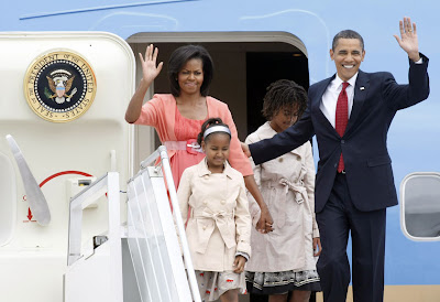 Barack Obama with his family exiting a plane during US Presidential elections, 2011