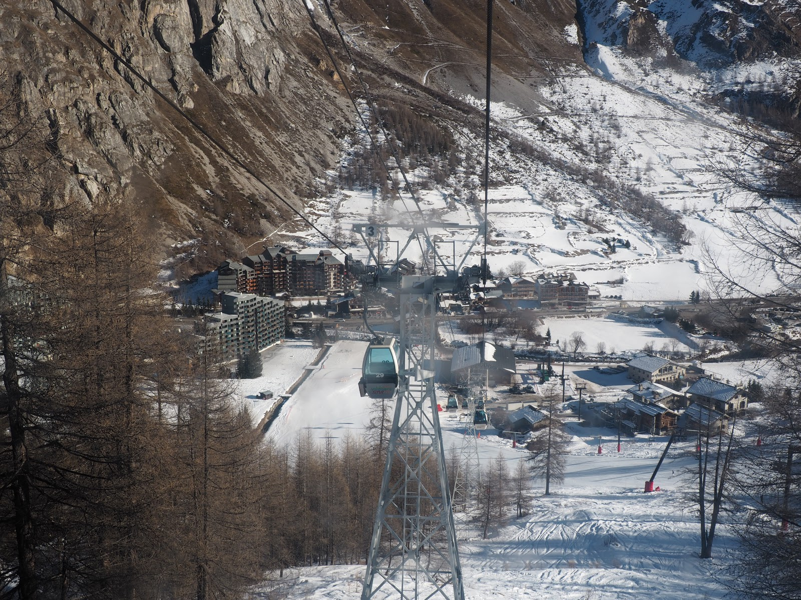 Cable cars in Val d'Isere against a blue sky