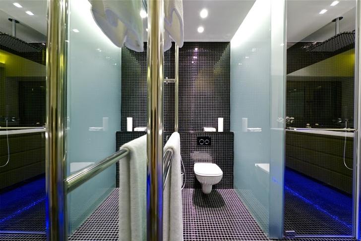 Shower cabin in black bathroom