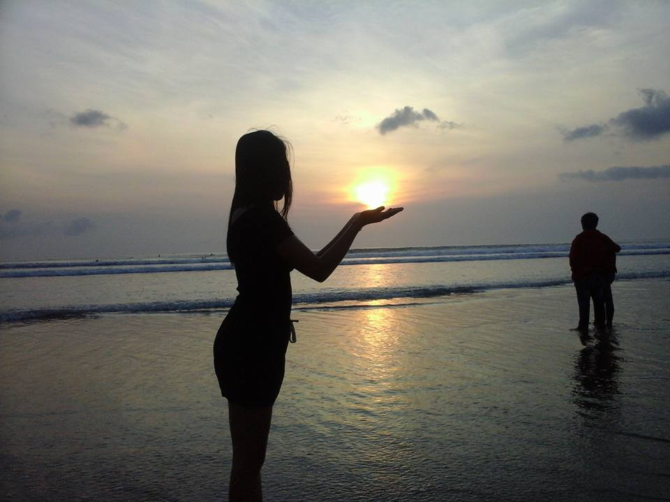 Girl with sunset in Bali beach