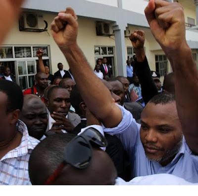 nnamdi kanu salutes supporters outside abuja court