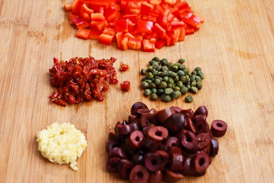 ... sun dried tomatoes, slice olives, mince garlic, and measure out the
