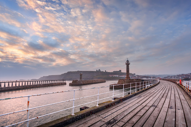Old pier at sunrise in Whitby North Yorkshire by Martyn Ferry Photography