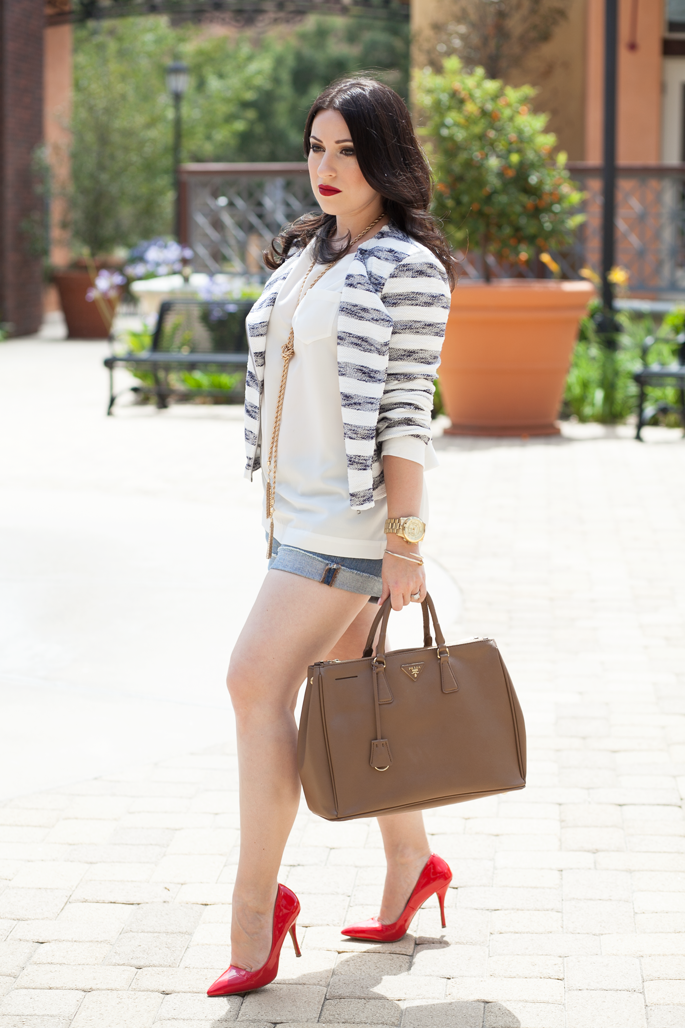 le-tote-cropped-striped-jacket-jcrew-denim-shorts-prada-bag-ily-couture-tassel-necklace-stila-red-lipstick-king-and-kind-steve-madden-red-pumps-jeweliq