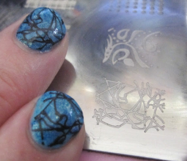 I took this squiggly line stamp and black and stamped over the saran wrap mani