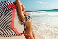 Sylvie van der Vaart shows off her body in a striped string bikini