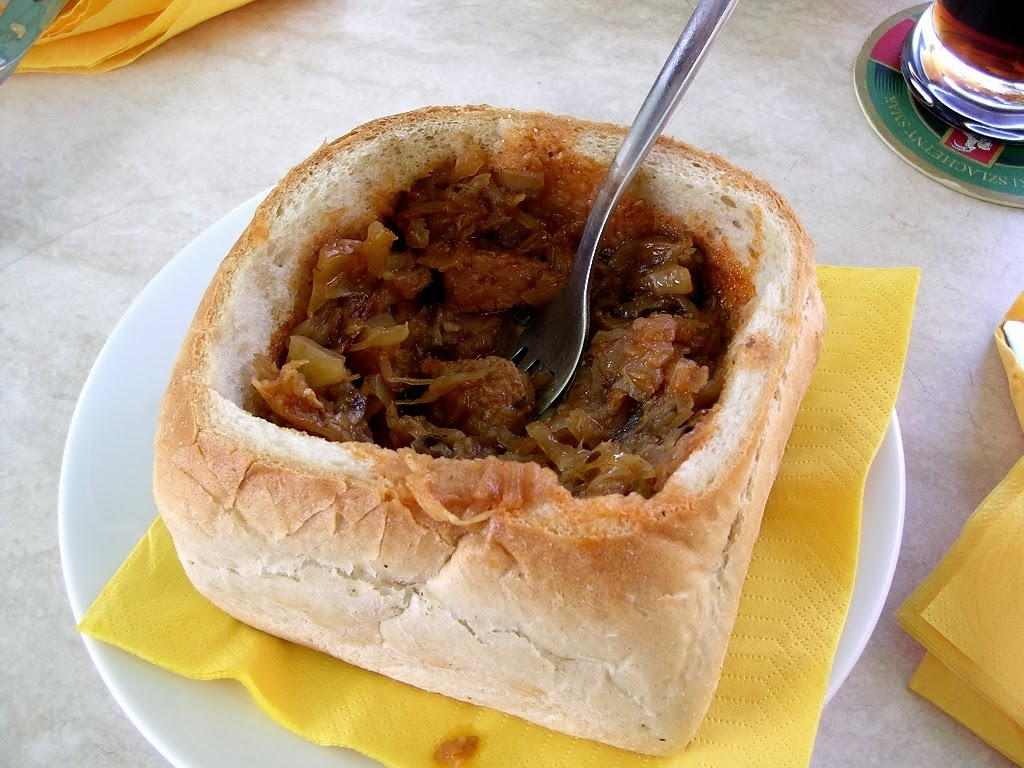 Bigos aka Hunter's Stew in bread served on Rynek Główny [Main Square] in Kraków Photo by Alberto Racatumba WikimediaCommons