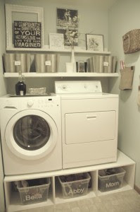 Laundry washer and dryer on pedestal with bins underneath :: OrganizingMadeFun.com