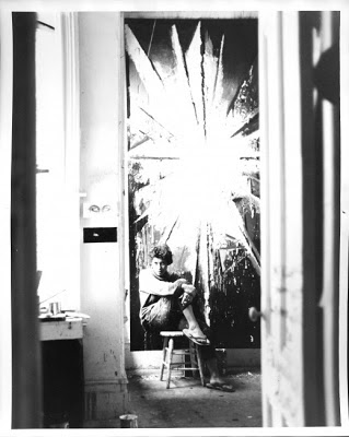Jay DeFeo sits in front of her painting entitled the rose