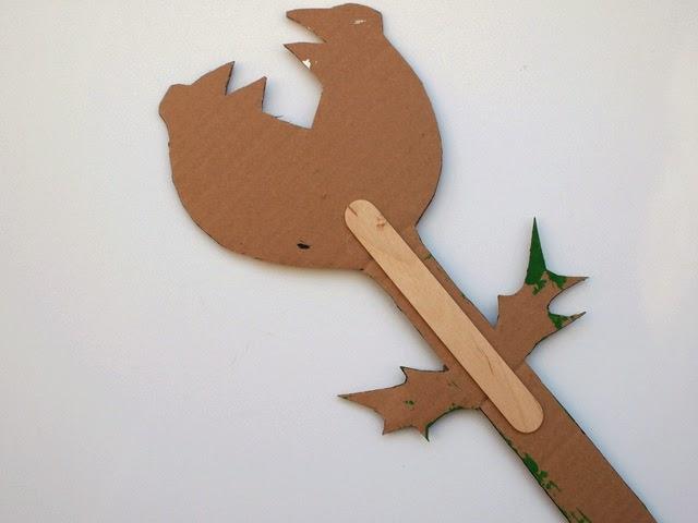 hot glue a craft stick to the back of your piranha plant