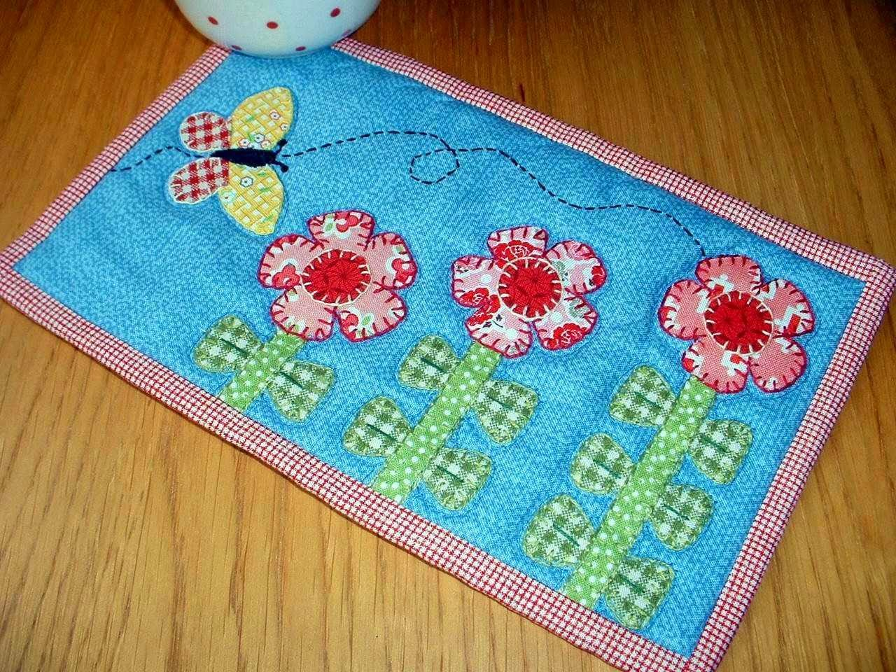 http://www.craftsy.com/pattern/quilting/home-decor/growing-flowers-mug-rug/47635