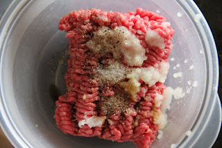 ground beef, salt, pepper, grated onion in a bowl
