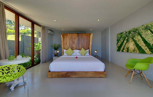 Picture of another bedroom with large wooden bed