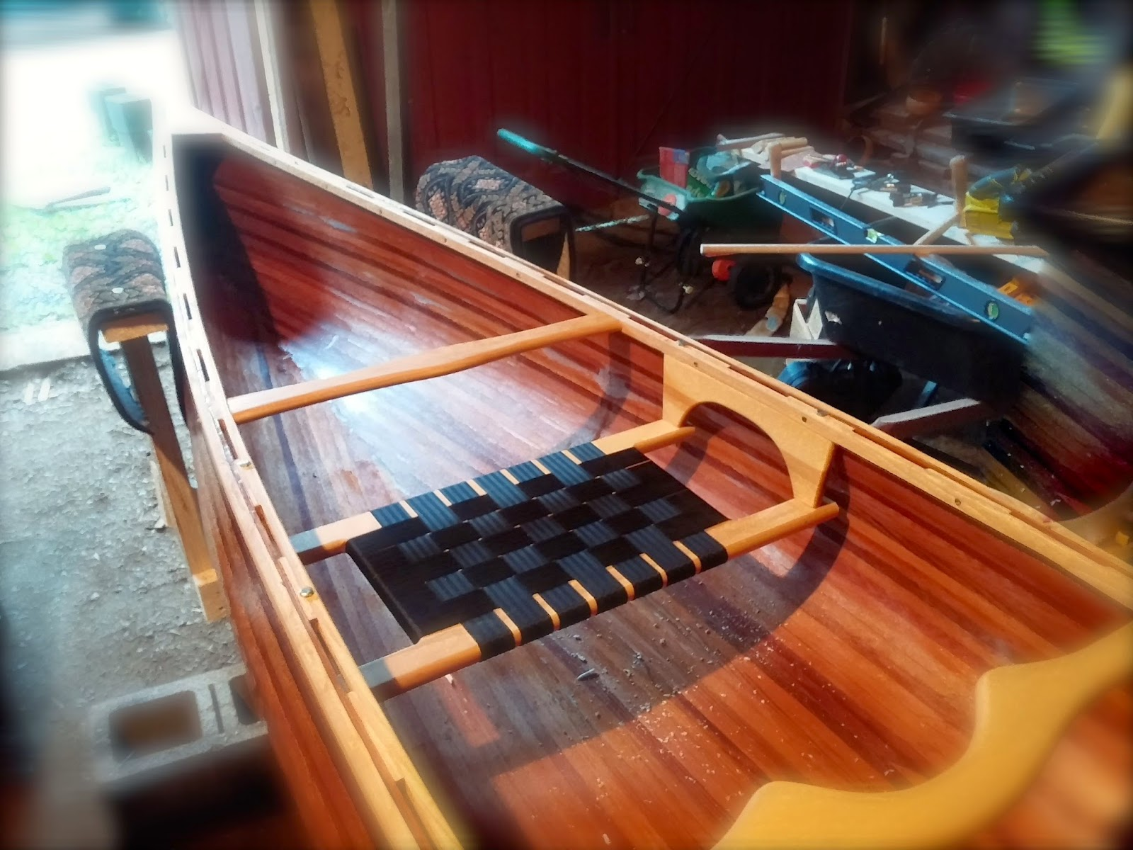 Gunwhale, scuppers, and seat installed: simplelivingeating.com