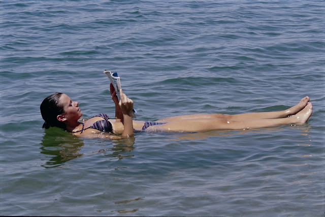 girl floating on dead sea