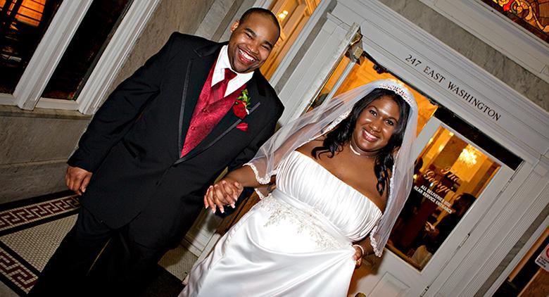 happy couple enters reception venue