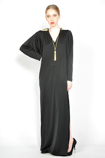 Vintage 1970's black maxi dress with gold details across the back and side slit opening.
