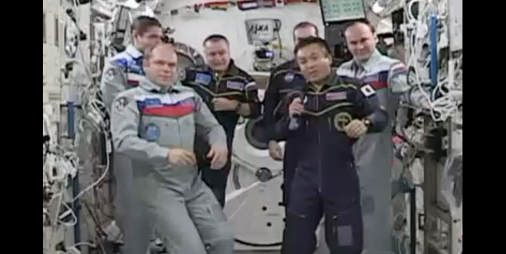 Expedition 38 Commander Oleg Kotov hands over control of the station to Japanese astronaut and Expedition 39 Commander Koichi Wakata during a Change of Command Ceremony. Image Credit: NASA TV