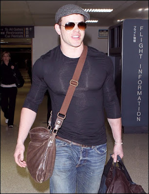 Kellan shows off in a shiny spandex shirt while hanging at the Airport.