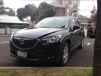 Handsome lines of the Mazda CX-5 slightly disguised by dark blue colour choice