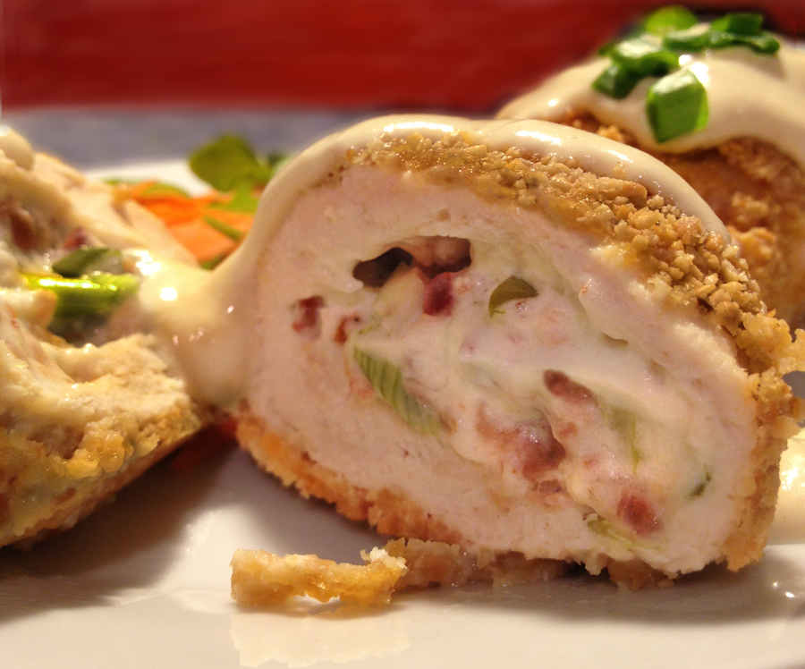 Chicken Cordon Bleu sliced to show chevre and bacon inside