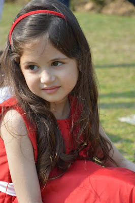 cute munni photo in red dress