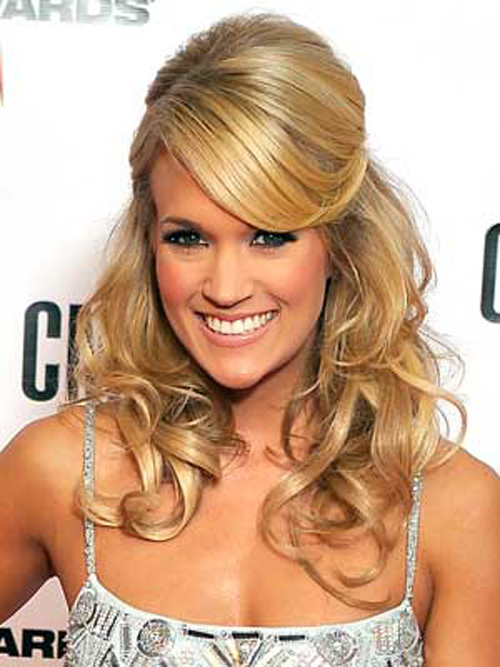 Carrie Underwood keeps it classy with shiny curls, pulled-back sides and a volumized bump at her crown.
